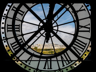 Fototapeta Paryż Paris cityscape through the giant clock at the Musee d'Orsay with view on the Seine river, Tuileries Garden, Palais royal, Opera Garnier, Sacre-Coeur and Montmartre hill - Paris, France