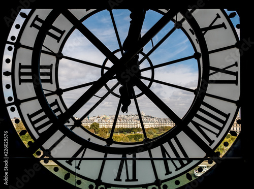 Fotografie, Obraz Paris cityscape through the giant clock at the Musee d'Orsay with view on the Se