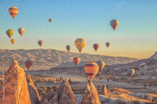 Amazing sunrise over Cappadocia. Colorful hot air balloons.