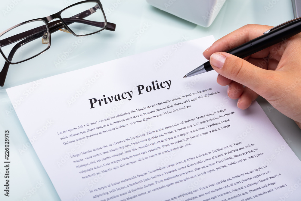 Fototapeta Woman Holding Pen Over Privacy Policy Form