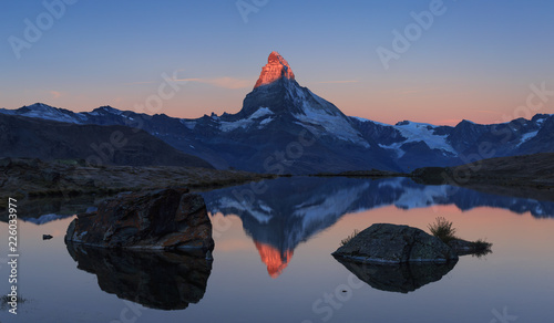 Spoed Fotobehang Reflectie The famous Matterhorn reflected in the Stellisee during sunrise. Zermatt, Switzerland.