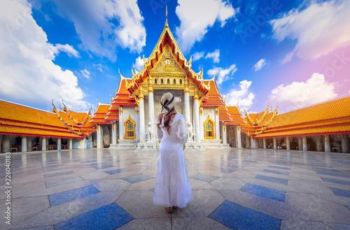 Poster Bangkok Asian woman tourist visit the beauty of Wat Benchamabophit,Bangkok thailand.