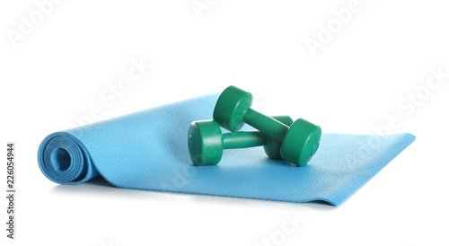 Yoga mat with dumbbells on white background Obraz na płótnie