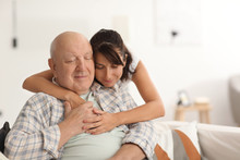 Happy Elderly Man With His Daughter At Home