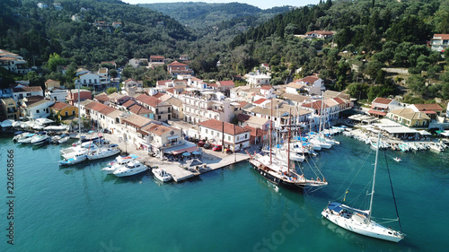 Foto op Plexiglas Cyprus Aerial drone bird's eye view photo of iconic small port and fishing village of Lakka with traditional Ionian architecture and sail boats docked, Paxos island, Ionian, Greece