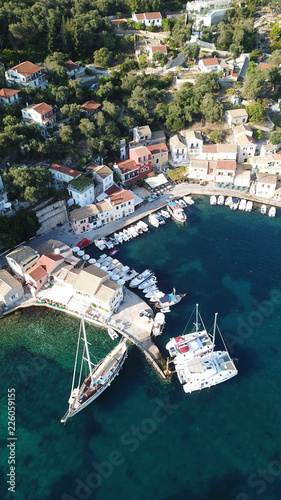 Fotobehang Liguria Aerial drone bird's eye view photo of iconic small port and fishing village of Logos with traditional Ionian architecture and sail boats docked, Paxos island, Ionian, Greece