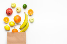 Paper Bag With Fruit Assortment On White Background