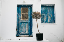 Traditional Greek Blue Doors And Window With Blue Shutters