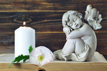 Memorial Candle, Angel Figurine And Flower