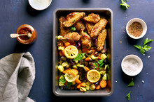 Grilled Chicken Wings With Vegetables In Baking Tray