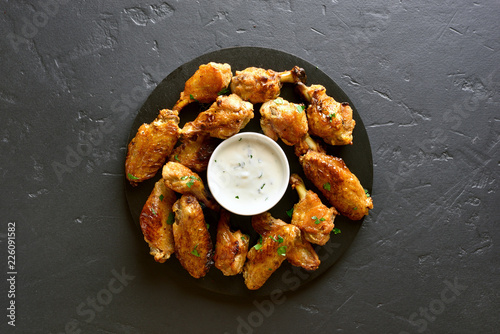 Grilled chicken wings with sauce