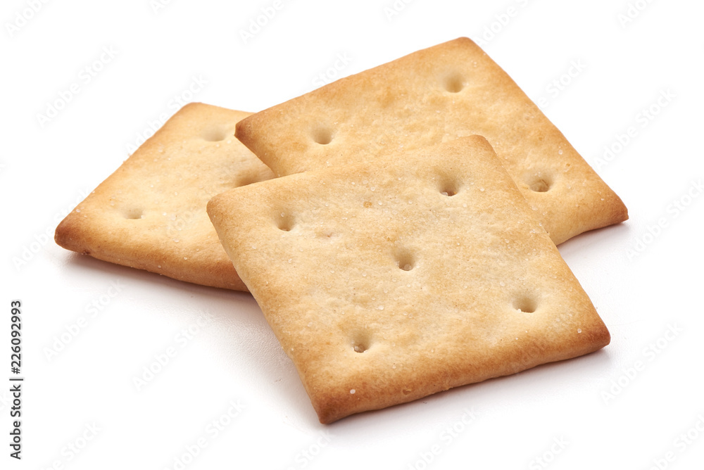 Fototapeta Salted cracker biscuit, close-up, isolated on white background.