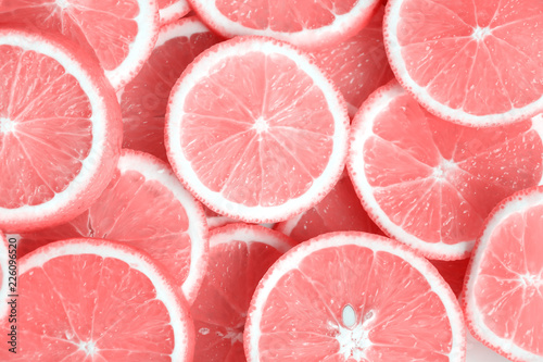 Leinwand Poster Pink citrus fruits - cuts, slices, halves