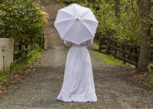Edwardian Woman Holding Parasol In Garden