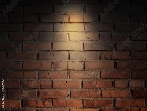 Foto op Aluminium Wand brick wall and spotlight. scene illuminated spotlight. bricks wall background.