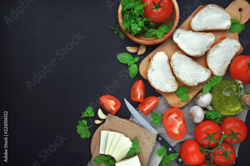 Fresh cheese with tomatoes and fresh herbs.Preparation of healthy food.