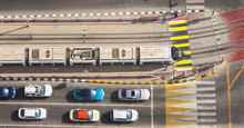 Cars And Tram In Intersection City. Aerial View