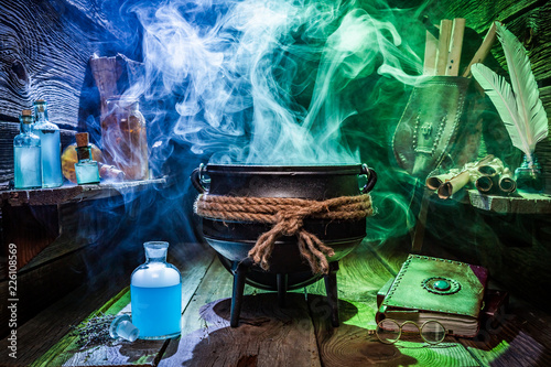 Witcher cauldron with magic potions and books for Halloween Canvas Print