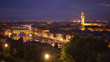 In focus backdrop of Florence, Italy at night with bright city lights