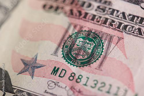 Stamp on fifty dollar bill