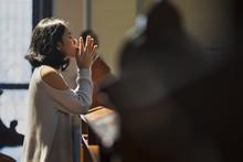 Christian Asian Woman Prays In The Church