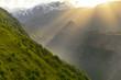 Sun rays between mountain peaks in Georgia