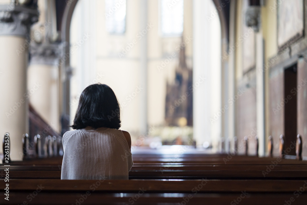 Fototapety, obrazy: Rear view of devout woman praying in the church