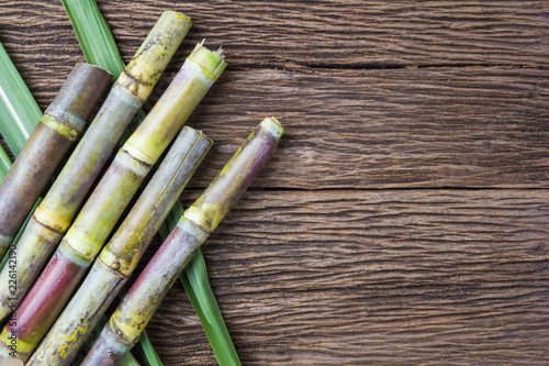 Fotografija Close up sugarcane on wood background close up..