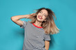 Leinwanddruck Bild - Beautiful young woman with healthy long blonde hair on color background