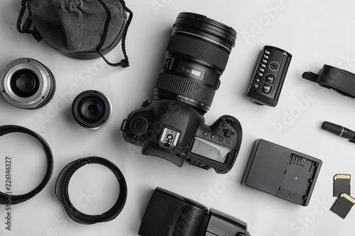 Fotografia Flat lay composition with photographer's equipment and accessories on white back