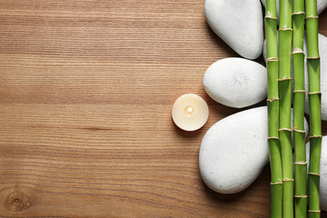 Panel Szklany Do Spa Flat lay composition with green bamboo stems on wooden background. Space for text