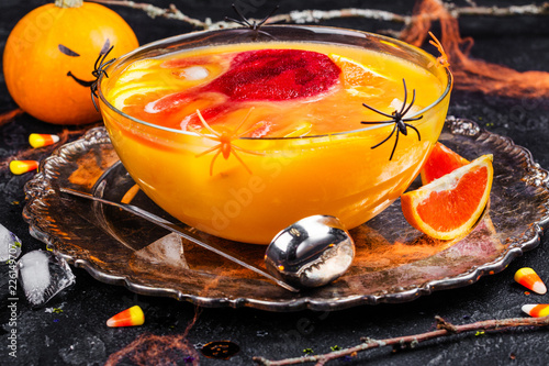 Staande foto Cocktail Ghoul's punch in a glass bowl