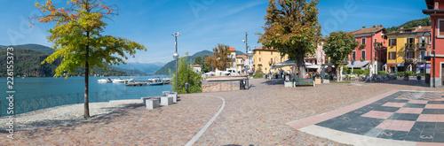 Foto auf AluDibond Dunkelgrau Picturesque village, lake promenade and historical center, with restaurants and bars, in Porto Ceresio (square Bossi), Lake Lugano, Italy. Important tourist destination on the border with Switzerland