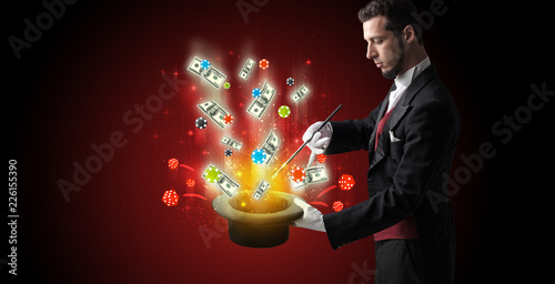 фотография  Illusionist conjure with magic wand gambling things from a cylinder