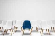 Blue Chair Among Rows Of White Chairs, Choice