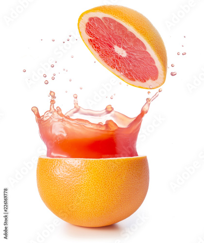 juice splashing out of a grapefruit isolated on white