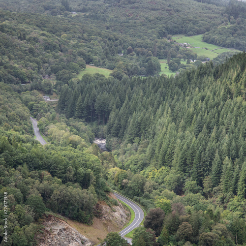 Landscape image of view from Precipice Walk in Snowdonia overlooking Barmouth and Coed-y-Brenin forest during rainy afternoon in September