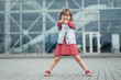 Portrait of One Little Girl Wearing Stylish Clothes Outdoors, Fashion Kid Concept