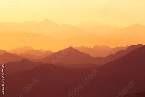 A beautiful, colorful sunrise sceney in mountains in purlpe tone. Abstract, minimalist landscape in Tatra mountains. Color gradients. Tatra mountains in Slovakia, Europe.