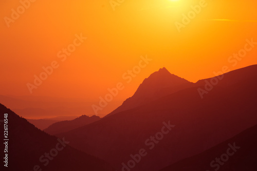 A beautiful minimalist landscape during the sunrise over mountains in warm tones. Abstract, colorful scenery of mountains in morning. Tatra mountains in Slovakia, Europe.