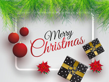 Top View Of Poster Or Banner Design Decorated With Hanging Bauble, Gift Boxes And Pine Leaves For Merry Christmas Celebration Concept.