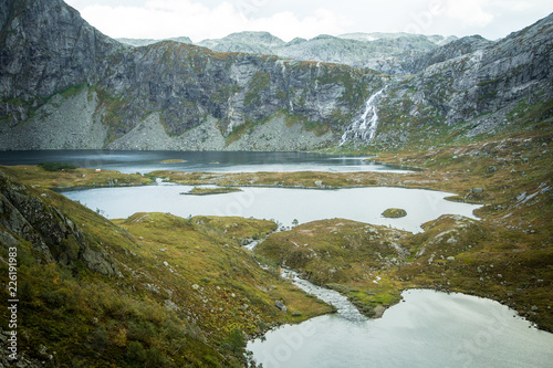 Aluminium Prints New Zealand A beautiful landscape of a mountain lake in Folgefonna National Park in Norway. Overcast autumn day in mountains. Autumn scenery of lake.