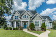 Leinwanddruck Bild - Gray New Construction Modern Cottage Home with Hardy Board Siding and Teal Door with Curb Appeal