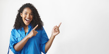 Look At This. Horizontal Shot Of Emotional Gorgeous Joyful Young African American Female Having Excited Fascinated Facial Expression, Keeping Mouth Wide Opened And Pointing Fore Fingers Upwards
