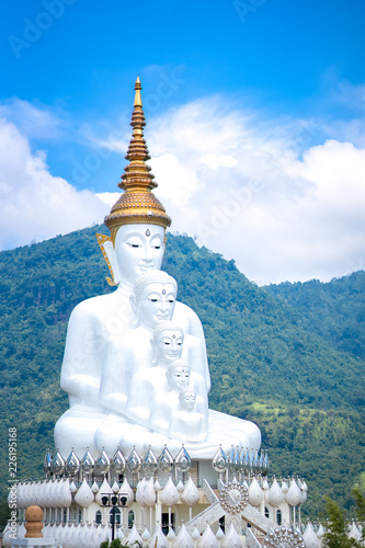 Deurstickers Bedehuis Big white Buddha statue in famous temple of Thailand on blue sky and cloud
