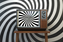 Propaganda And Brainwashing Of The Influential Mass Media Concept. Vintage TV Set With Hypnotic Spiral On The Screen.