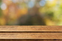 Empty Wooden Step Table Over Autumn Nature Bokeh Background