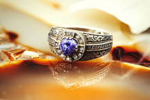 Gold Metal Ring With Blue Ston...