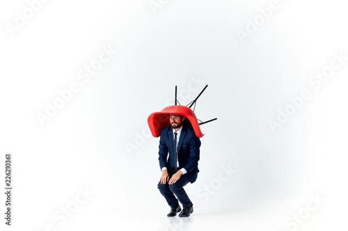 Valokuva  a chair on a man's head