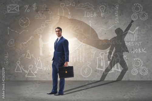 Fotografering  Businessman and his shadow in business concept